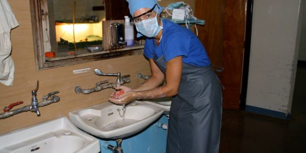Then: Ellen scrubs for a caesarean section in Haydom Lutheran Hospital in Tanzania